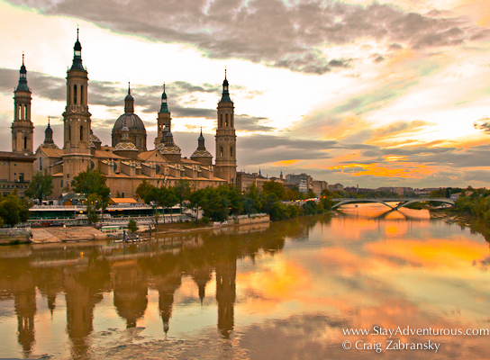 the best sunset view in zaragoza, from atop the bridge of lions and the rio ebra with the basilica el pilar