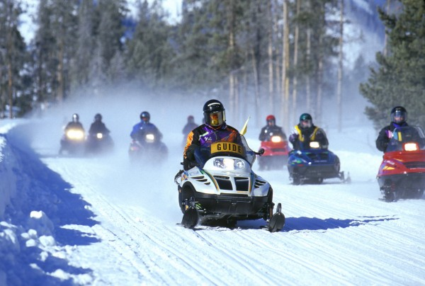snow mobile through Grand Teton National Park in the winter