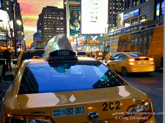 the NYC Sunset, catch a cab or the sunset in manhattan on 7th avenue