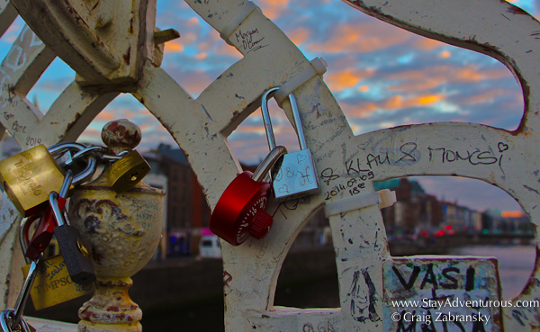 Love Locks, Love Padlocks on the Ha'Penny Bridge in Dublin, Ireland at Sunset