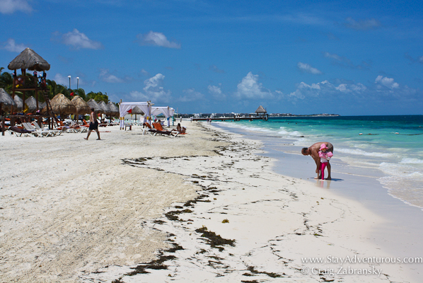a view down the beach at Dreams Riviera Cancun in Puerto Moreles