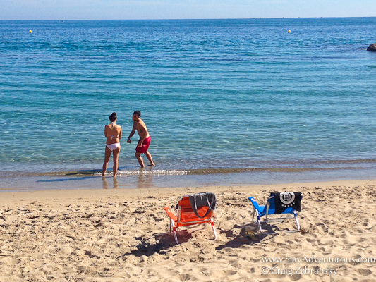 a couple enjoying the beaches of L'Ametlla del Mar, Spain