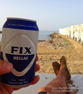 relaxing on the island of Crete at the Knossos Beach Bungalows with a look Greek Fix beer