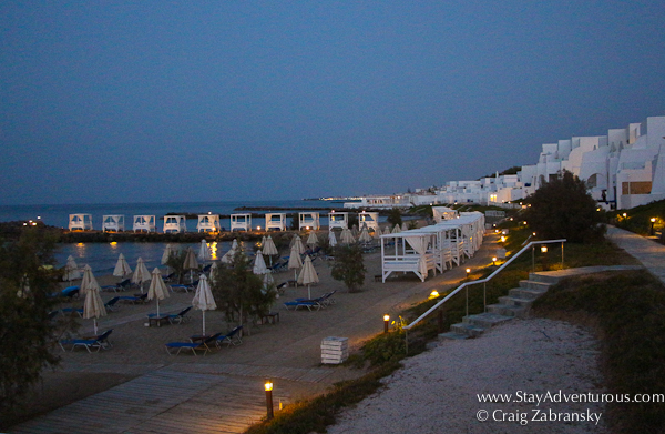 the view of the beach at night at the Knossos Beach Bungalows and Suites on the Greek island of Crete