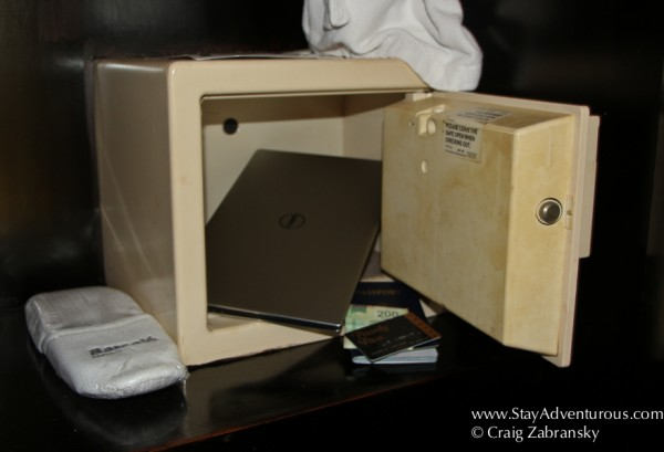 stuffing a notebook into a safe