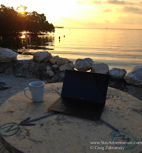 At sunrise, starting the workday in the florida keys with coffee and the dell xps