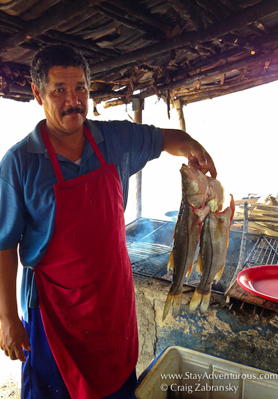 a chef prepares the famous fish dish Zarandeado in Mexcaltitan, Nayarit