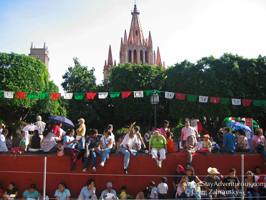 lining the street for the independence day parade in San Miguel de Allende