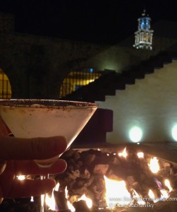 enjoying a night time cocktail in the lobby at La Purificadora in Puebla, Mexico