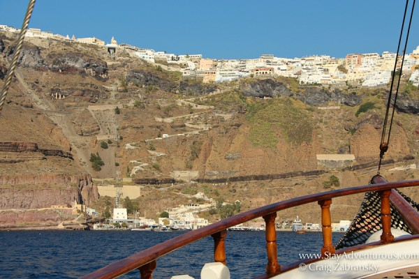on the tourism excursion boat at sea with the best views of Santorini