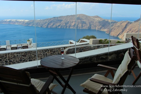 a little toast to the best views of Santorini from a wine bar in Imerovigli