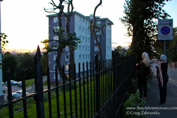 fellow onlookers enjoying a british treat, the london skyline at sunset