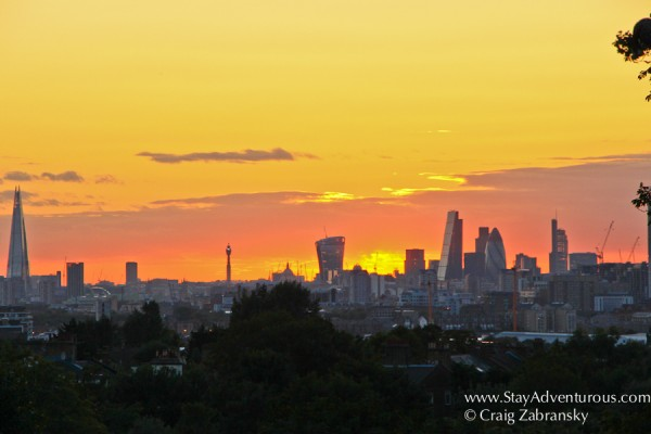 the sunset view of the london skyline from charlton outside greenwich, uk