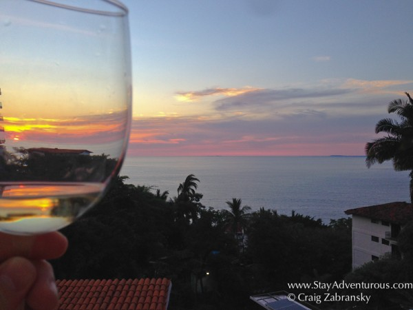toasting the sunset overlooking the Bay of Banderas in Puerto Vallarta, Mexico