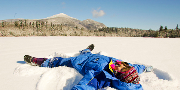 Making a Snow Angel out Lake Placid in the Adirondacks of New York