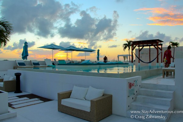 the sunset view of the main pool on the roof of the Palm at Playa in Playa del Carmen, in the Riviera Maya of Mexico