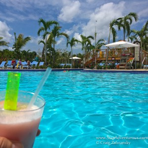 A poolbar drink inside Amber Cove Carnival Cruise Port for Fathom Travel in the Dominican Republic