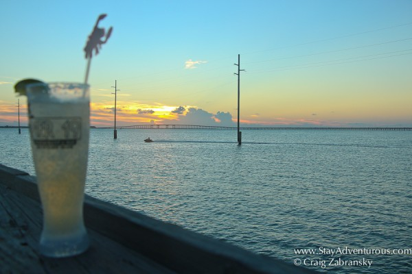 the pier 19 cocktail watching the south padre island, texas sunset