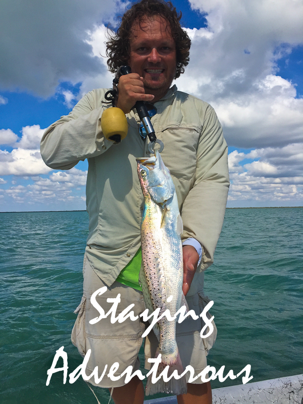 showing off speckled trout caugh in laguna madre on trip to south padre island, texas
