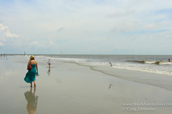 Woman and Child enjoying a stroll on the sands at hunting state park near beaufort, south carolina