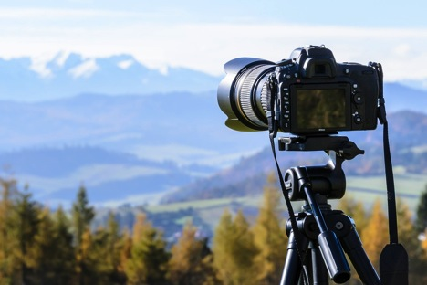camera taking an image of the mountains