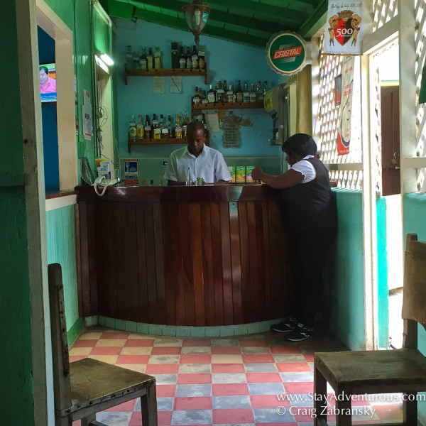 a bartender makes my mojto in a son dance hall in the heart of Santiago de Cuba