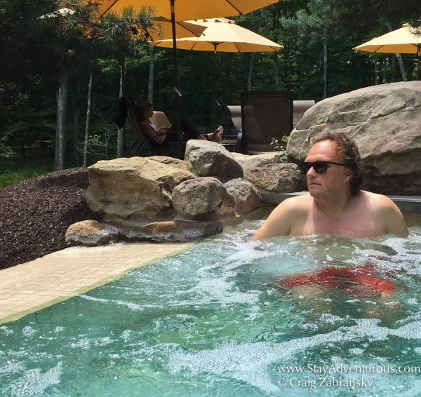 Craig Zabransky with DKNY Sunglasses from SmartBuyGlasses in the hot tub at the lodge at Woodloch