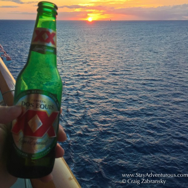sunset cerveza on the balcony of my state onboard the NCL Getaway in the Caribbean