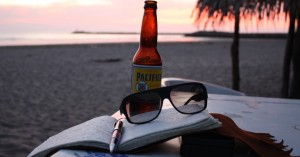 writing in a journal at sunset in mexico