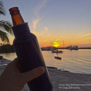 sunset and the bottle keeper on the beach