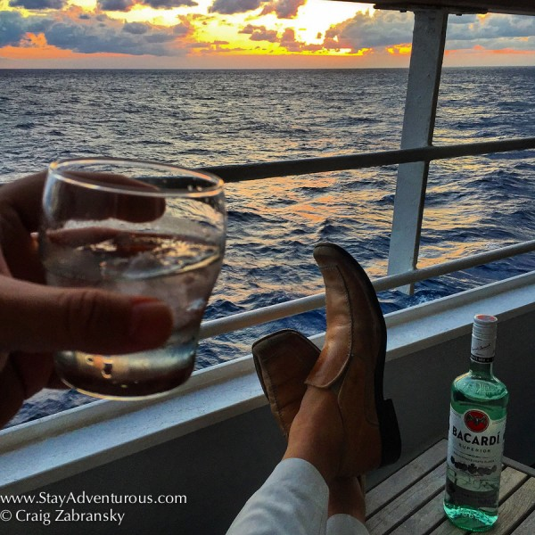 toasting bacardi en route to santiago de cuba on board the fathom mv adonia at sunset