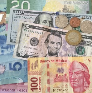 photo of Mexican Pesos, Canadian Dollars and US dollars, MXN, CAD, USD