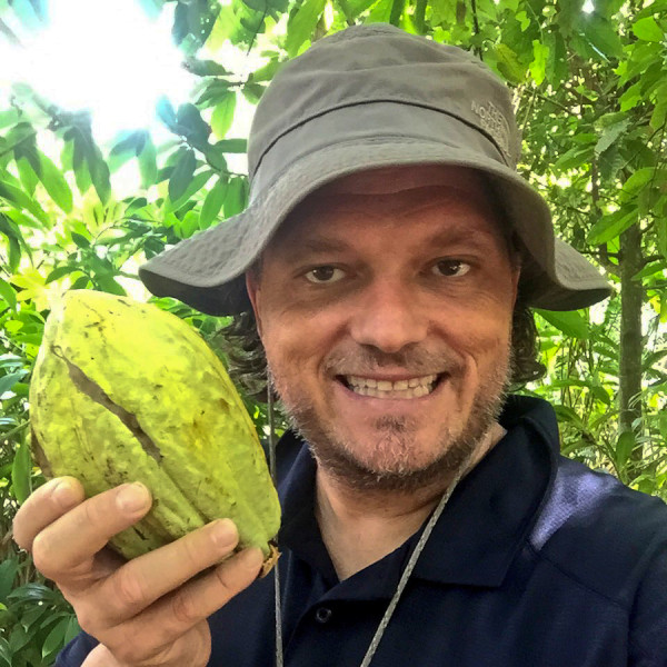 Craig Zabransky Staying Adventurous in Tabasco Holding a Cacao Fruit