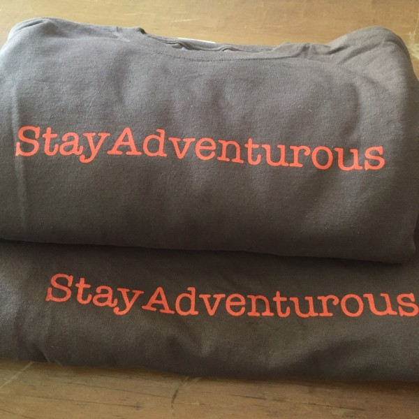 stay adventurous t-shirts by CreateAShirt in Orange Bach, AL