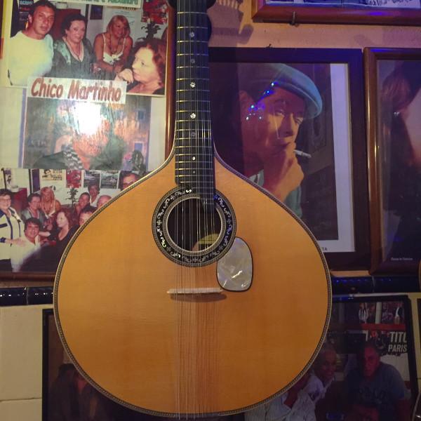 the Fado music Portugese Guitar inside Tasca do Chico in Barrio Alto, Lisbon Portugal