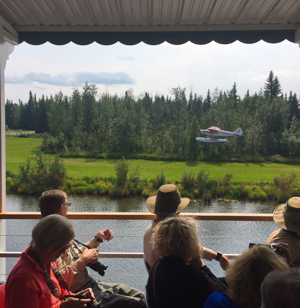 the bush pilot in a seaplane takes off on the chena river from the Riverboat Tour on the Discovery III in Fairbanks, AK