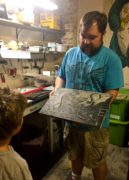 locla artist describes his craft inside the Lowe Mill Arts and Entertainment Complex