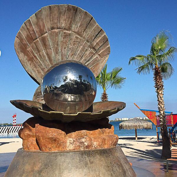 the perarl sculpture on the malecon in la paz mexico