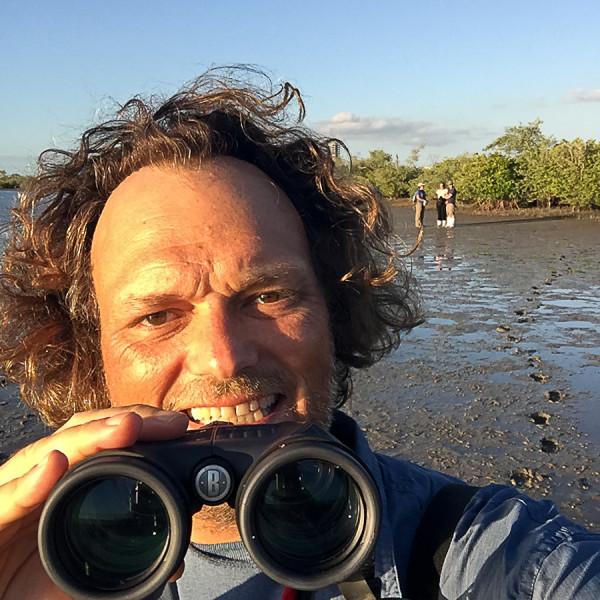 blogger with binoculars bird watching in la paz, baja california sur, mexico