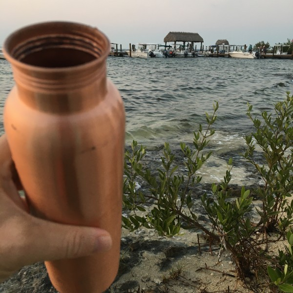 taking a sip by the sea out of my copper h20 water bottle