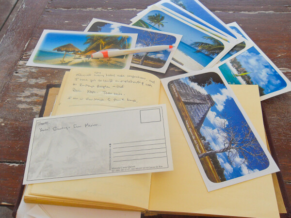 writing postcards on travels to Mexico