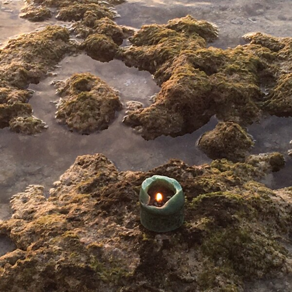 candle burns brightly during sunset in islamorada