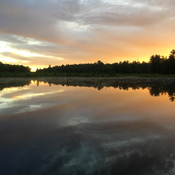 A summer sunrise at Little Teedyuskung Lake at the Lodge at Woodloch
